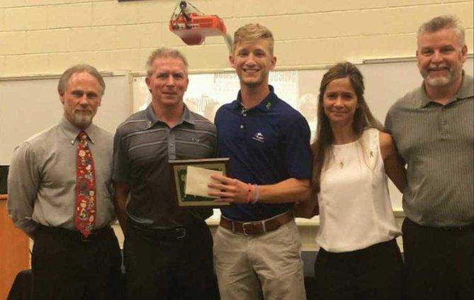 Drew Ridings receiving the scholarship 950