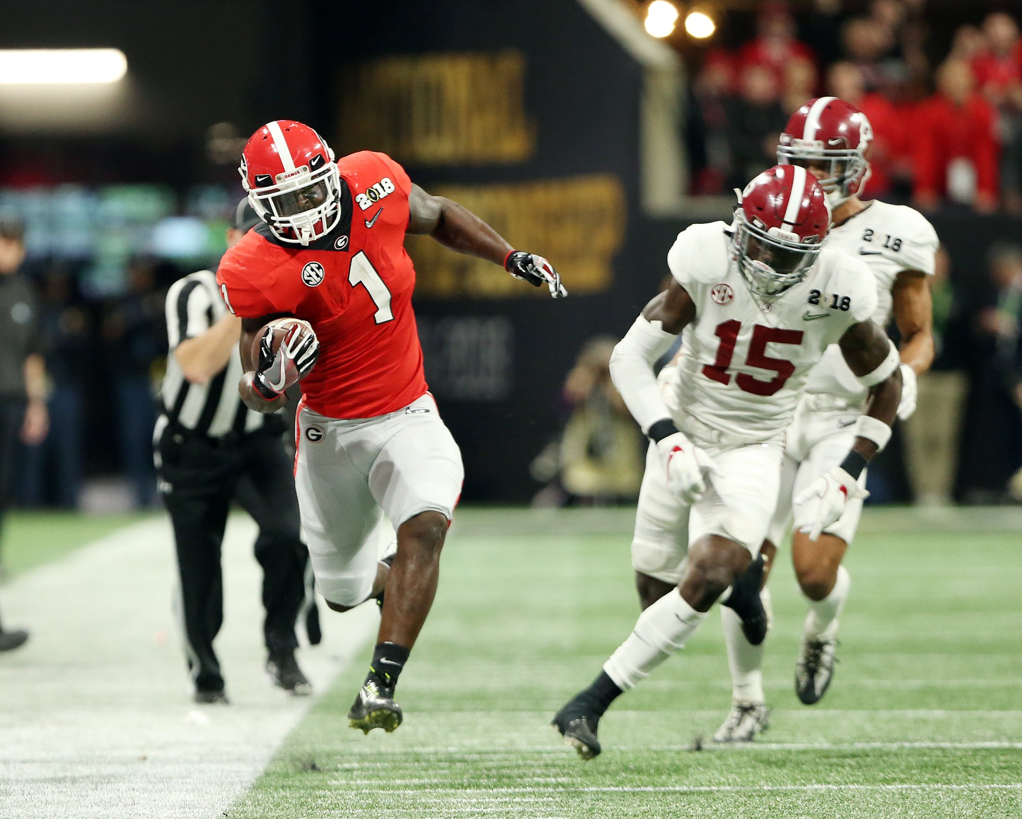 Sony Michel tip-toes down the sideline for extra yards after a catch