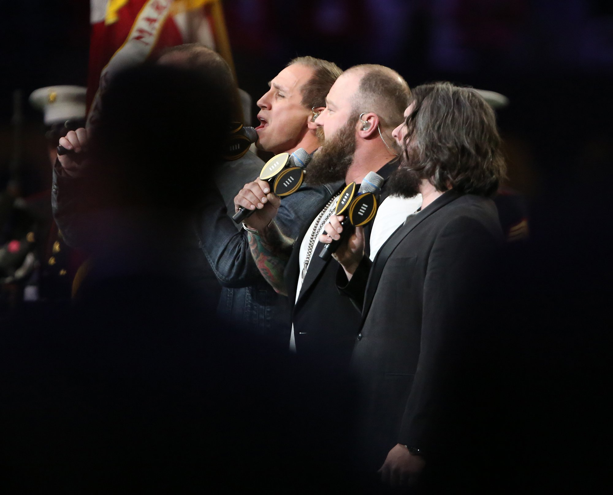 Members of the Zac Brown Band sing the national anthem