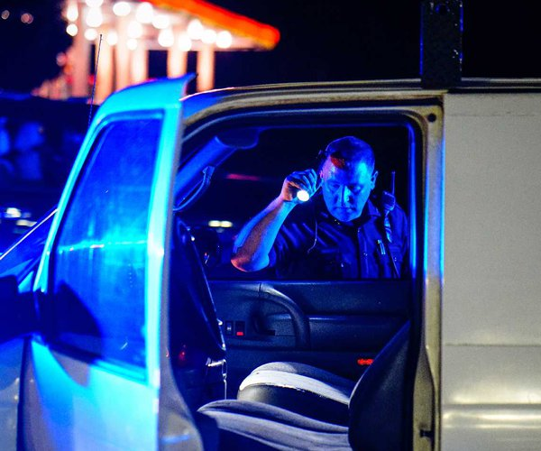 A deputy looks inside a van involved in a chase
